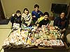 [写真]出発前、COOP様から届いた応援食材をジュニア選手たちが仕分け作業