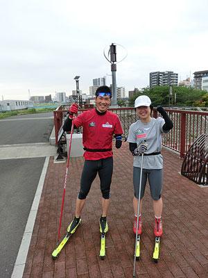 [写真]ガッツポーズの新田佳浩選手と太田渉子選手