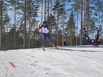 [写真]フィンランド大会女子バイアスロンスプリント6km競技で力走する阿部選手
