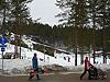 [写真]積もった雪と人々